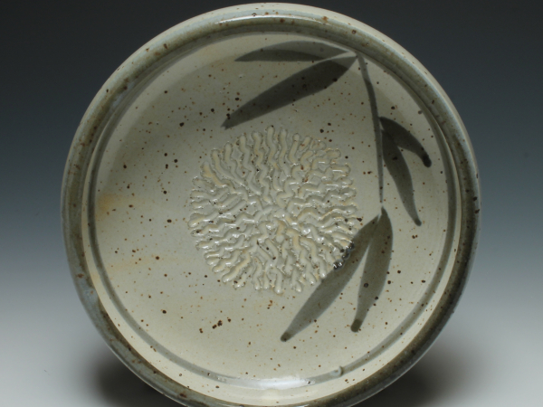 Dipping dish with garlic grater top view shown in Leaf