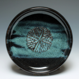 Dipping dish with garlic grater top view shown in Northern Lights