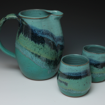 pitcher with cups in mountain design